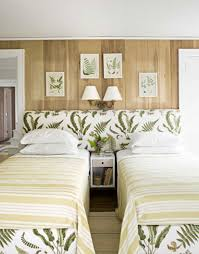 Twin Bed Upholstered Headboard by Use An Over Sized Upholstered Headboard To Unify Two Twin Beds And