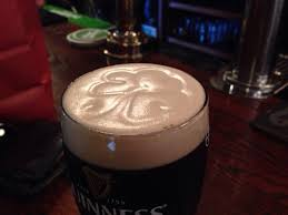the correct way to pour a guinness a four leaf clover pattern
