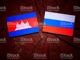 Eussian Flag Cambodian Flag With Russian Flag On A Tree Stump Isolated Stock