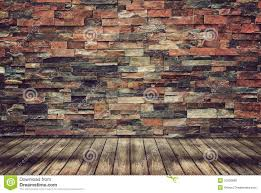 wood floor and brick wall for vintage wallpaper stock photo