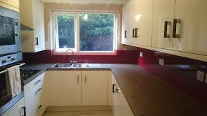 red glass splashbacks for kitchens and bathrooms
