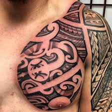 half chest and sleeve guam tribal tattoo