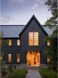 grey vertical siding and steel roof make this modern farm