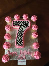 chocolate number 7 cake with zebra print fondant pipes with