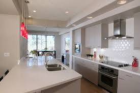modern australian grey and white galley kitchen with timber floor