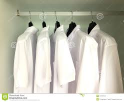 white shirts hanging on the racks stock photo image 47578740