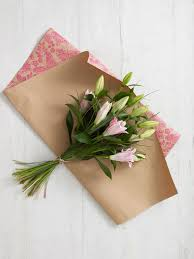 flower wrapping paper how to wrap a bouquet of flowers hgtv