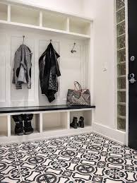 mudroom gray and black mosaic tile floor built in bench shoe