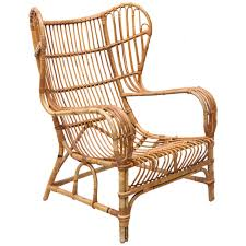 vintage bamboo and cane wingback lounge chair at 1stdibs