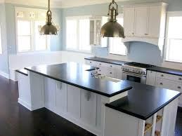 kitchens with white cabinets and brown countertops kitchen