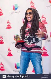 tego calderon winner of best urban music album poses in the press