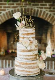 picture of one tier dirty icing wedding cake with berries and fruits