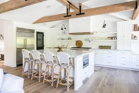 white kitchen cabinets with wood beams spacious open design kitchen with eat in island white