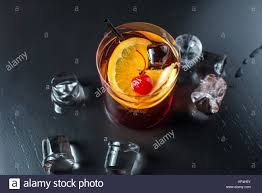 black russian cocktail black russian cocktail with a cherry and orange stock photo