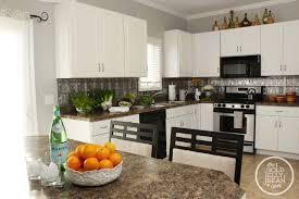 how to put up backsplash in kitchen planning to put up this faux tin tile backsplash up in my kitchen