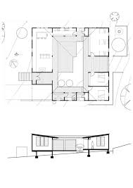 Courtyard Plans by Small Vacation Home Wraps Around Large Private Courtyard