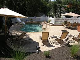 pool patio materials stamped concrete vs pavers
