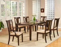 varnished long dining room table pads with 8 black wood chairs