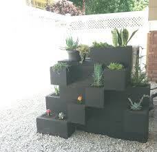 painted cinder blocks planter succulents hide air conditioner