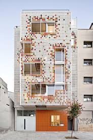 multifamily multifamily housing designed with a shiny colorful ceramic facade