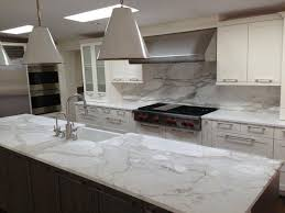 backsplash for kitchen countertops a remodeled kitchen with a slab of granite island matching