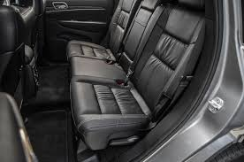 grey jeep grand cherokee interior 2014 jeep grand cherokee v 6 and v 8 first tests truck trend