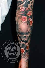 skull and cherry blossoms by jeff gogue tattoos