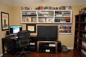 high shelves keep the floor clear in this gaming room gaming