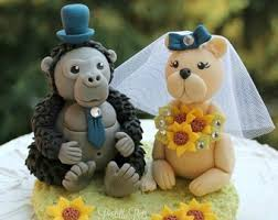 duck and monkey wedding cake topper with banner for names and
