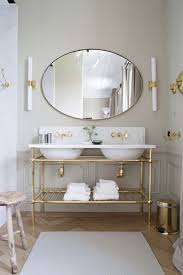 brass bathroom mirror architectural digest bathrooms gray bathroom gold and gray