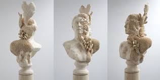 carved wood sculptures of surreal figures