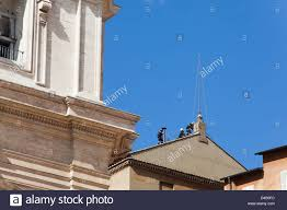 vatican firefighters install a chimney on roof sistine