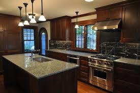 kitchen with stone backsplash dark wood floors dark cabinets