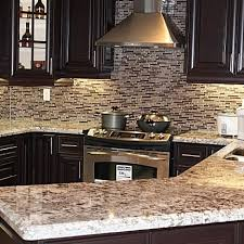 what backsplash goes with brown cabinets how backsplash tile will make or your kitchen