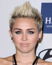 whats the name of the haircut miley cyrus usto have trendy short funky faux hawk haircut for women miley cyrus short