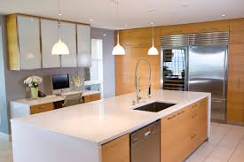modern built in kitchen cupboards green painted island with wooden top built in wine rack brass
