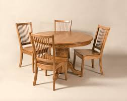 expandable round pedestal dining table with 4 wood dining chairs