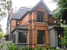 image result for charcoal window frames against brick house
