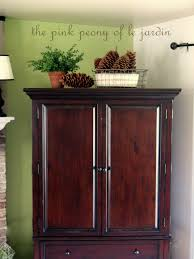 Top Of Armoire Decor Decorating Armoire Tops 28 Images Decorate The Top Of An