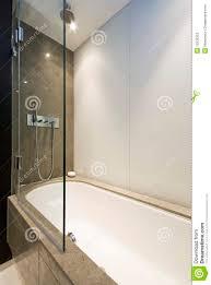 marble bath tub with slim line shower attachment stock photos attachment bath marble modern shower