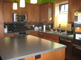 black backsplash tile and elegant wooden cabinet for kitchen