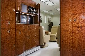 custom aircraft cabinets inc custom aircraft cabinets opens 5 9 million plant woodworking network