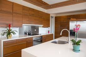 kitchens with stainless steel backsplash contemporary kitchen with waterfall countertop european cabinets