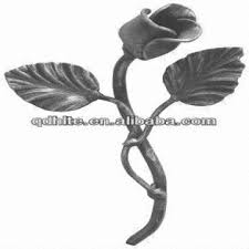 ornamental wrought iron flower and leaf on fence stairing gate