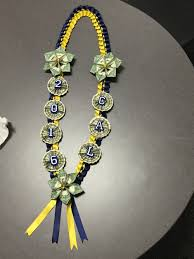 navy blue and yellow money lei ready for graduation grad