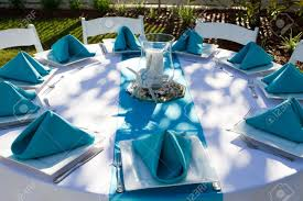 wedding silverware outdoor dinner table is setup with plate silverware and folded