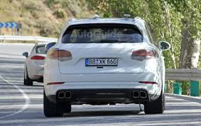 porsche suv white 2017 2018 porsche cayenne smiles for the camera wearing all white