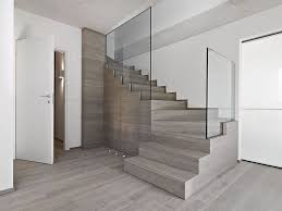interior modern staircase with glass railing design in white