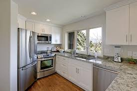 maple kitchen cabinets with white granite countertops white shaker maple pius kitchen bath