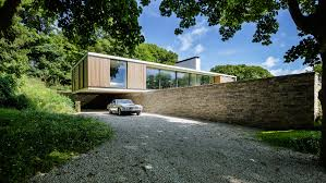 simple house with perforated wooden top wall also black marble